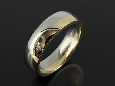 Gents Two tone 18kt Yellow and White Gold Polished 6mm Court Shaped Design.