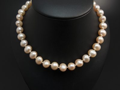 Peach Freshwater Pearl Necklace 9-10mm With A Gold Plated Silver Lobster Clasp. Available In Store £350.00