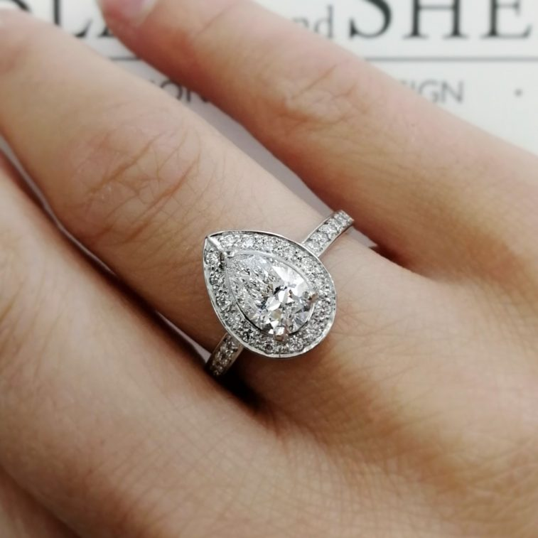 Engagement Ring Pear Cut 1.08ct H Colour SI2 Clarity with Round Brilliant Cut Diamonds 0.45ct Total in a Platinum Claw and Pavé Set Halo Design.