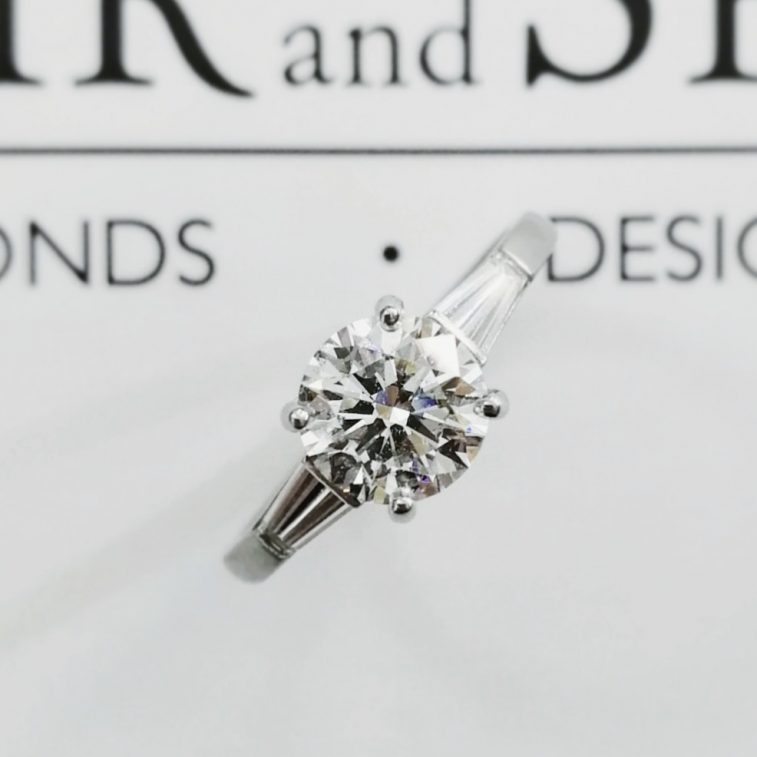 Engagement Ring Round Brilliant 1.30ct E Colour SI2 Clarity with Tapered Baguette Cut Diamonds in a Platinum Setting.