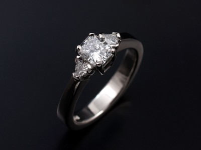 Hand–made palladium trilogy engagement ring. Radiant cut diamond centre stone 0.70ct F colour SI1 clarity minimum with 2 x Trilliant cut diamonds (0.17ct) G colour SI clarity minimum.