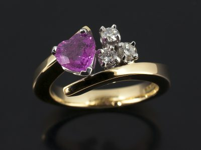 Heart Shaped Pink Sapphire 0.88ct with Round Brilliant Cut Diamonds 0.18ct Total in a 9kt Yellow and white Gold Setting.