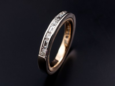 Princess Cut and Baguette Cut Channel Set White Gold Eternity Ring with Yellow Gold Inner Sleeve
