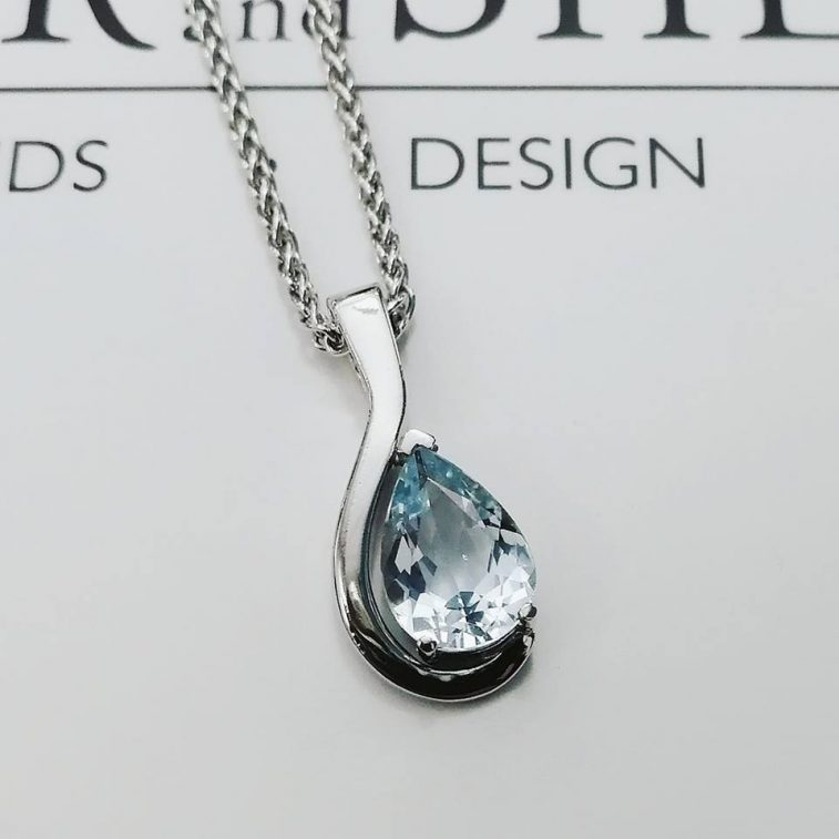 Pear Cut Aquamarine Pendant 1.49ct in a 9kt White Gold Claw Set Twist Design with Matching Chain.