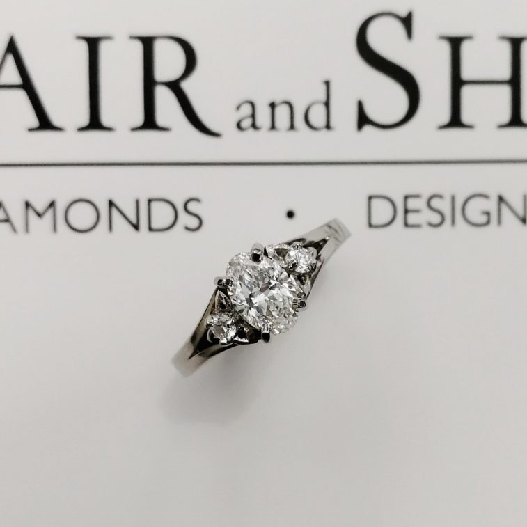 Engagement Ring Oval Cut Diamond 0.61ct E Colour VS1 Clarity and Round Brilliant Cut Side Diamonds 0.08ct Total in a Palladium Celtic Inspired Split Band Design.