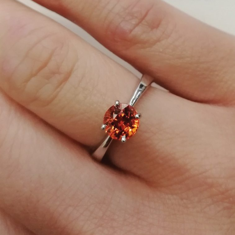 Dress / Engagement Ring Round Brilliant 1.42ct Orange Sapphire in a 9kt White Gold 4 Claw Solitaire Design.