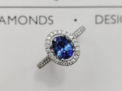 Dress / Engagement Ring Oval Ceylon Sapphire 1.25ct with Round Brilliant Cut Diamonds 0.25ct Total in a Platinum Halo Design.