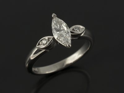 Marquise Cut 0.40ct D Colour SI1 Clarity with Round Brilliant Cut Bead Set Side Diamonds in a Palladium Trilogy Design.