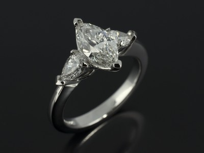 Marquise Cut 0.90ct F Colour SI1 Clarity with Pear Cut Diamonds 0.40ct in a Platinum Trilogy Setting.
