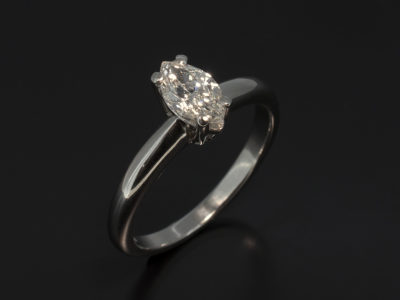 Marquise 0.50ct H Colour SI1 Clarity in a Platinum 4 Claw Set and Halo Shaped Band Design.