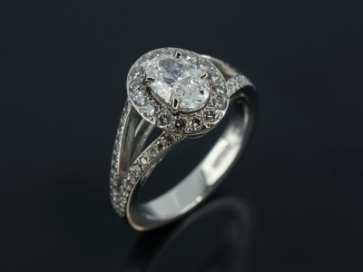 Oval 0.74ct E Colour Flawless Clarity in a Platinum Pave Set Halo Design with Split Shoulders