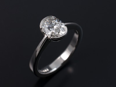 Oval 1.01ct F Colour SI1 Clarity Excellent Polish and Symmetry in a Half Rub Over Platinum Setting
