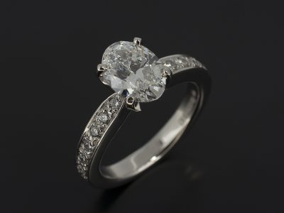 Oval Cut Diamond 1.01ct D Colour SI1 Clarity, Excellent Cut, Excellent Symmetry Claw Set in Platinum with a Pavé Set Round Brilliant Cut Diamond Shoulder 0.14ct (14) F Colour, VS Clarity Minimum