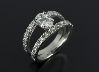 Oval Cut 1.01ct D Colour SI2 Clarity with Double Row Diamond Claw Set Bands in Palladium.