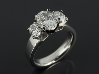 Oval Cut 1.20ct F Colour SI1 Clarity with Oval Cut Side Diamonds 0.67ct in a Contemporary Platinum Trilogy Setting.