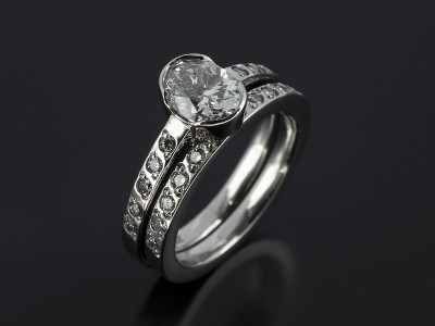Oval Cut 1.01ct D VS2 with Fitted Platinum Bead Set Wedding Ring.