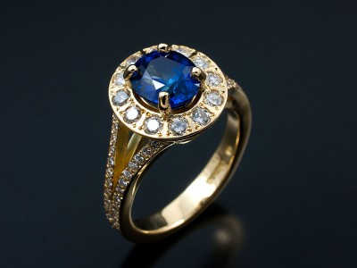 Oval 2.01ct Ceylonese Sapphire with Multiple Round Brilliants Pave Set into Halo and Split Shoulders in 18kt Yellow Gold