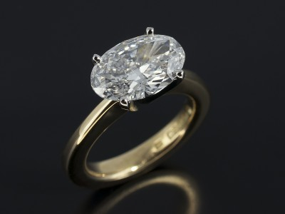 Oval Cut 2.11ct D Colour SI2 Clarity EX Polish VG Clarity in a 4 Claw Platinum and 18kt Yellow Gold Setting.