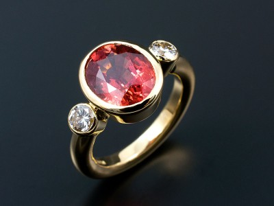 Oval 4.2ct Blood Orange Sapphire with 2 x 0.20ct F VS Round Brilliants in 18kt Yellow Gold Rub Over Settings Copy