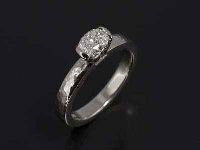 Oval Cut Diamond, 0.50ct, D Colour, SI1 Clarity, Excellent Polish, Very Good Symmetry Part Rub-over Set in Platinum with a Hammered Finish