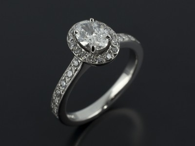 Oval Cut 0.50ct G Colour SI1 Clarity in a Palladium Pavé Set Halo Design.