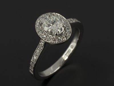Oval Cut Diamond, 0.52ct, E Colour, VS2 Clarity, Very Good Polish, Very Good Symmetry Four Claw Set in Platinum with a Round Brilliant Cut Diamond, 0.24ct (30), Pavé Set Halo and Shoulder