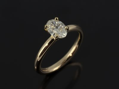 Oval Cut Diamond, 0.61ct, F Colour, SI1 Clarity Four Claw Set in 14kt Yellow Gold