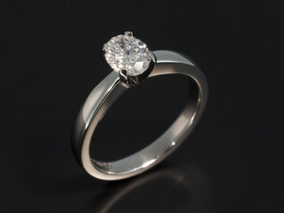Oval Cut 0.71ct D Colour SI1 Clarity EXVG in a Platinum 4 Claw Contemporary Solitaire Design.