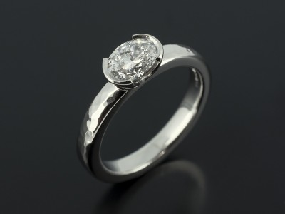 Oval Cut 0.71ct E Colour SI1 Clarity in Platinum Half Rub Over Setting with Hammered Band.