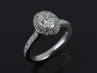 Oval Cut 0.71ct F Colour SI1 Clarity in a Platinum Diamond Set Halo Design.