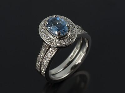Oval Cut Aquamarine 0.70ct in a Palladium Diamond Set Halo Design with Fitted Diamond Set Wedding Ring.