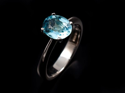 Oval Aquamarine 2.7ct set in a 9kt White Gold 4 Claw Setting with a Tapered Knife Edged Band. Copy