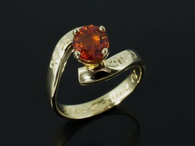 Oval Blood Orange Sapphire 1.65ct in an 18kt Yellow Gold 4 Claw Twist.
