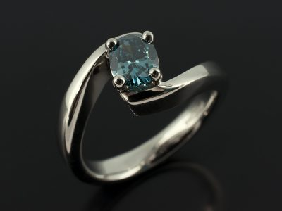 Oval Cut Blue Diamond 0.63ct in a 4 Claw Palladium Twist Setting.