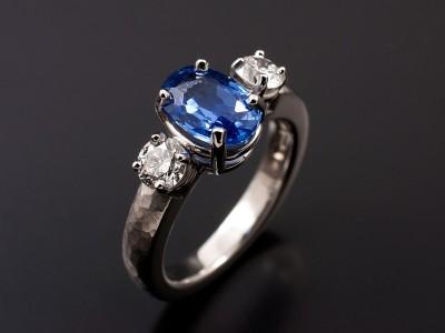 Oval Ceylonese Sapphire 1.65ct with 2 x 0.25ct F VS Round Brilliant Diamonds Hand Made in Palladium with a Hammered Matt Band