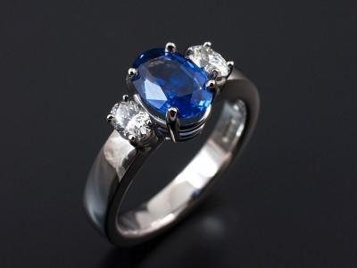 Oval Ceylonese Sapphire 1.74ct with 2 x 0.31ct F VS Oval Cut Diamonds in a Palladium Setting. Copy