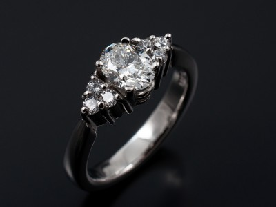 Oval Cut 0.75ct G Colour VVS1 Clarity with 6 Round Brilliant Diamonds Hand Made in a Palladium Setting.