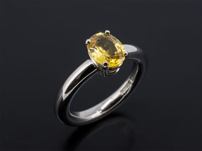 Oval Cut Yellow Sapphire 1.35ct Claw Set in White Gold In A Solitaire Design
