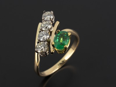 Oval Cut Emerald 0.63ct with 4 x 0.20ct Round Brilliant Diamonds in an 18kt Yellow Gold Twist Design.