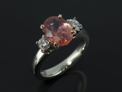 Oval Peach Sapphire 2.67ct with 2 x Round Brilliant Cut Diamonds 0.36ct Total F Colour SI Clarity in an 18kt Rose Gold and Platinum Setting.