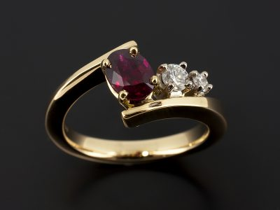 Oval Cut Ruby 1.04ct with 0.16ct and 0.06ct Round Brilliant Diamonds in an 18kt Yellow and White Gold Twist Claw Set Design.