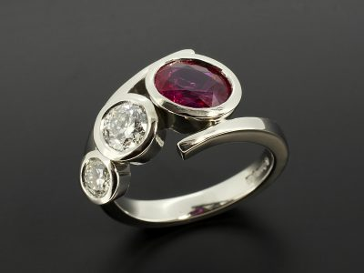 Oval Cut Ruby 1.15ct and Round Brilliant Cut Diamond 0.60ct D Colour SI1 Clarity & 0.27ct F Colour VS Clarity Set In Platinum with a Rub Over Design