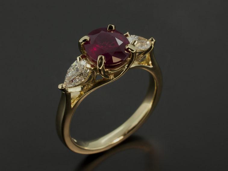Oval Cut Ruby 1.81ct, Pear Cut Diamonds 0.62ct x 2 F VS 18kt Yellow Gold Trilogy Design