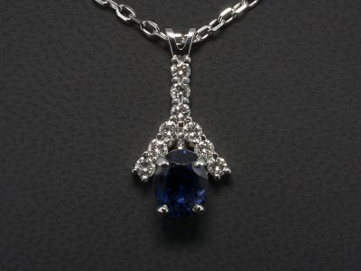 Oval Cut Sapphire, 3.50ct and Round Brilliant Cut Diamond 0.56ct (9), F Colour, SI1 Clarity Pendant Claw Set in 18kt White Gold