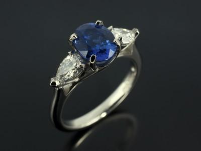 Oval Cut Ceylon Sapphire 1.68ct with Pear Cut Diamonds 0.47ct D Colour VS1 Clarity in a Palladium Trilogy Claw Set Design.