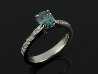Oval Cut Blue Diamond 0.73ct in a Platinum 4 Claw Pavé Set Design.