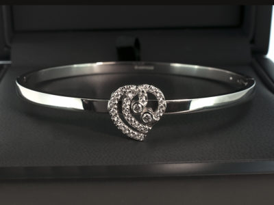 Platinum Hinged Bangle Claw & Rub-over Set Heart Design with Round Brilliant Cut Diamonds, 0.47ct Total.