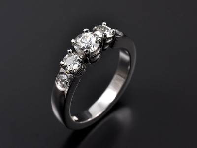 Palladium 5 Stone Ring Comprising 0.39ct, 0.34ct(2) and 0.12ct(2) Round Brilliant Diamonds.