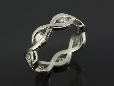 Palladium Seven Diamond Eternity Ring in a Swirl Tension set Design.