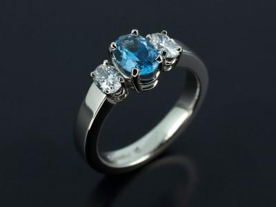 Palladium Trilogy Design with Aquamarine 0.60ct with Oval Cut Diamonds 0.46ct Total F Colour SI Clarity Min Copy